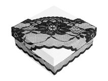 Stylish white gift box, decorated with exquisite black lace ribbon Royalty Free Stock Image