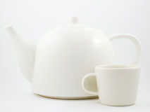 Stylish white porcelain teapot and cup Stock Image