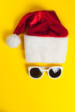 Stylish white sunglasses with red hat santa claus Stock Images