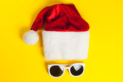 Stylish white sunglasses with red hat santa claus Royalty Free Stock Image