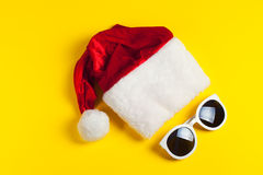 Stylish white sunglasses with red hat santa claus Royalty Free Stock Photography