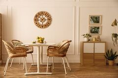 Free Stylish White Table And Wicker Chairs In Room. Interior Design Royalty Free Stock Photography - 221550097