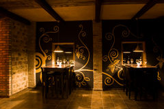Stylish wine bar interior. Interior of stylish modern dimly lit wine bar Stock Photos