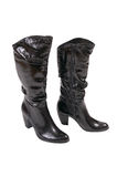 Stylish winter boots for women on a white. Stock Photos