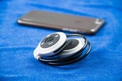 Stylish wireless bluetooth headset Royalty Free Stock Images