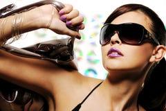 Stylish woman. Bright beautiful young woman with fashion sunglasses and handbag Royalty Free Stock Photo