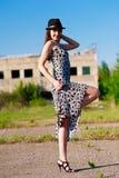 Stylish woman. Standing on one leg Stock Photography