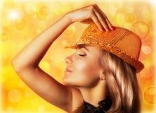 Stylish woman. Photo of beautiful blond woman wearing stylish golden shiny hat stock photo