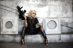 Stylish woman with assault gun Royalty Free Stock Photo