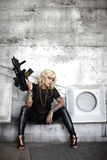 Stylish woman with assault gun Stock Photos