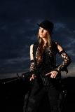 Stylish woman with assault rifle Stock Photo