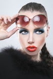 Stylish Woman With Beauty Makeup and Sunglasses Stock Photo