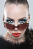 Stylish Woman With Beauty Makeup and Sunglasses Royalty Free Stock Photo
