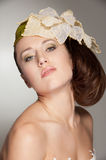 Stylish woman with big flower on her head Stock Image