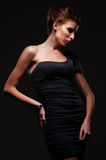 Stylish woman in black dress Stock Image