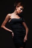 Stylish woman in black dress Stock Image