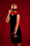 Stylish woman in black dress and sun glasses Royalty Free Stock Image