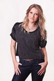 Stylish woman in blouse and jeans Royalty Free Stock Photography