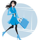Stylish woman in blue with purchases Royalty Free Stock Photography