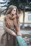 Stylish woman in brown coat and cotton scarf. Outdoors Royalty Free Stock Photos