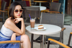 Stylish woman in cafe Royalty Free Stock Photos