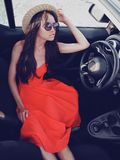 Stylish woman in car cabriolet. Outdoor lifestyle photo of beautiful stylish woman in car cabriolet. Holiday and travel. Summer trip. Freedom, youth and carefree Royalty Free Stock Photo