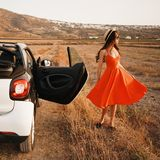 Stylish woman in car cabriolet. Outdoor lifestyle photo of beautiful stylish woman in car cabriolet. Holiday and travel. Summer trip. Freedom, youth and carefree Royalty Free Stock Image