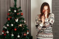 Stylish woman in christmas lights posing and smiling at christma Royalty Free Stock Images