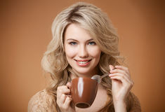 Stylish woman with coffee in hands Stock Photo