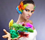 Woman with makeup and feathers Stock Photography