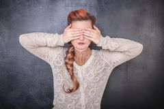 Stylish woman covering her eyes with hands royalty free stock image