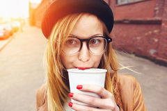 Stylish woman drinking coffee Stock Photography