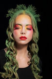 Stylish Woman with Dyed hairs and Extravagant Makeup Royalty Free Stock Images
