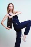 Stylish woman fashion girl holding black handbag Royalty Free Stock Images