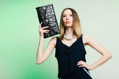 Stylish woman fashion girl holding black handbag Stock Photo