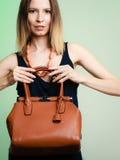 Stylish woman fashion girl holding brown handbag Stock Photography