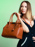Stylish woman fashion girl holding brown handbag Royalty Free Stock Photography