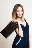 Stylish woman fashion girl holds handbag and shoes Stock Photos