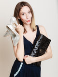 Stylish woman fashion girl holds handbag and shoes Royalty Free Stock Photo
