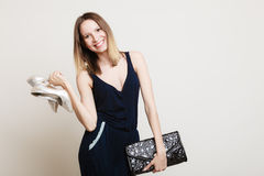 Stylish woman fashion girl holds handbag and shoes Royalty Free Stock Images