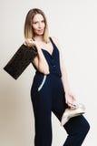 Stylish woman fashion girl holds handbag and shoes Royalty Free Stock Photo