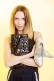 Stylish woman fashion girl holds handbag and shoes Stock Photography