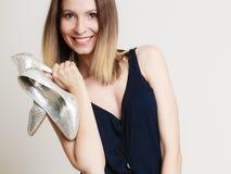 Stylish woman fashion girl holds high-heeled shoes Stock Image