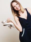 Stylish woman fashion girl holds high-heeled shoes Stock Images