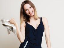 Stylish woman fashion girl holds high-heeled shoes Royalty Free Stock Photography