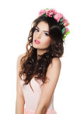 Stylish Woman Fashion Model with Flowers Wreath. Isolated on White. Brunette Beauty stock photography