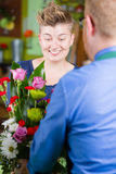 Stylish Woman in Flower Shop Purchases Arrangement Royalty Free Stock Photo