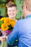 Stylish Woman in Flower Shop Purchases Sunflowers Royalty Free Stock Photography
