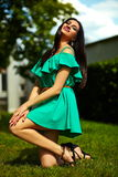 Stylish woman girl on casual green dress Royalty Free Stock Photos