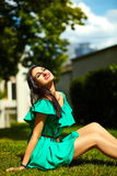 Stylish woman girl on casual green dress Stock Images